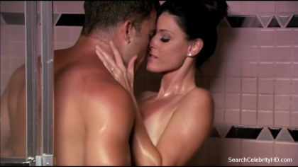 Seductive brunette fucking a guy she works with is in a shower stall